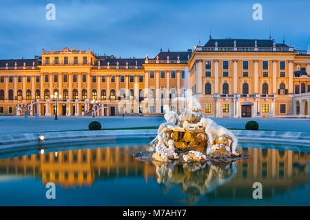 Blue hour with reflexion in the fountain on the forecourt of Schönbrunn Palace in Vienna - Stock Photo