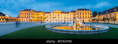 Panorama on the forecourt of Schönbrunn Palace in Vienna at the blue hour - Stock Photo