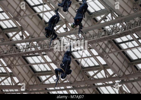 Demonstrative performance of police special forces (release of hostages) at the Luzhniki Stadium on the Day of the - Stock Photo