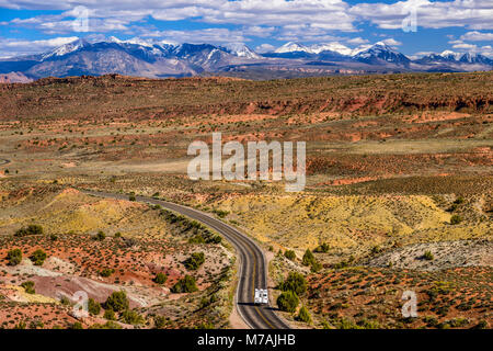 The USA, Utah, Grand county, Moab, Arches National Park, Salt Valley towards La Sal Mountains - Stock Photo