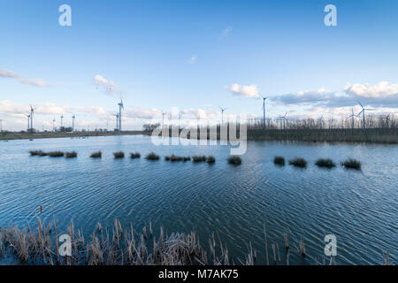Germany, East Frisia, wind power plants close to Emden - Stock Photo