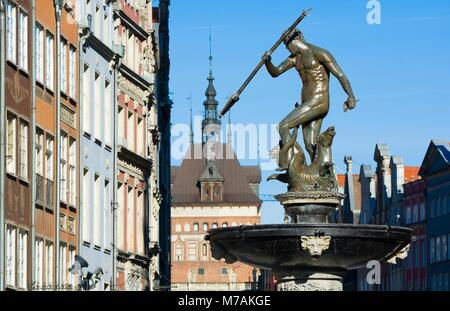 Neptune Fountain - symbol of Gdansk, located at Long Market, blurred Prison Tower and burgher houses in the background, - Stock Photo