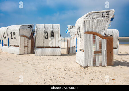 Europe, Germany, the North Sea, Lower Saxony, the East Frisians, Spiekeroog, beach chairs on the beach of Spiekeroog - Stock Photo