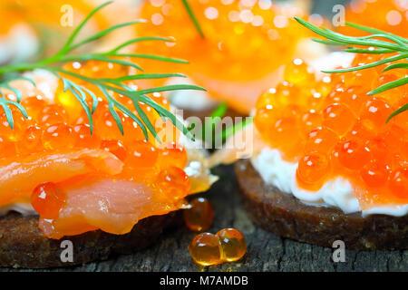 Canapés with salmon and caviar - Stock Photo