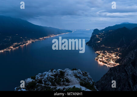 View high over Lake Garda at dark, Italy - Stock Photo