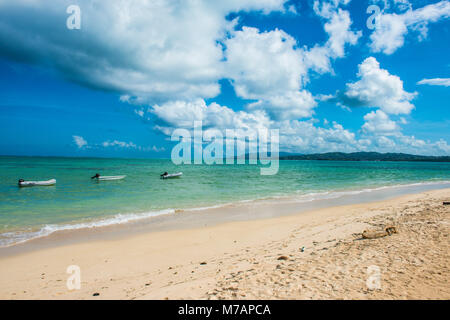 Three boats lined up in the turquoise waters of Pigeon Point, Tobago, Trinidad and Tobago, Caribbean - Stock Photo