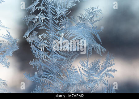 Ice Crystals In Window Glass, bokeh background - Stock Photo