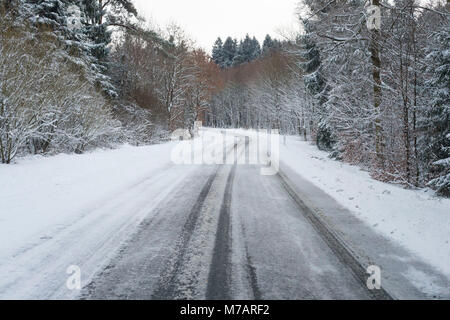 Snowy country road in winter, Wagenschwend, Odenwald, Baden-Wurttemberg, Germany - Stock Photo