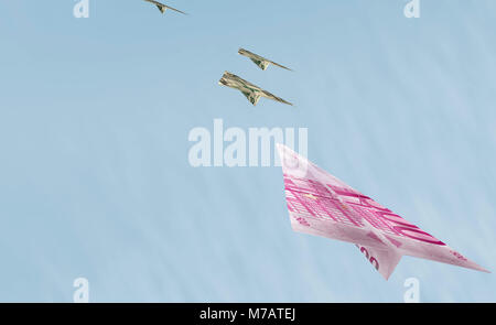 Bank notes in the shape of airplanes flying in the sky - Stock Photo