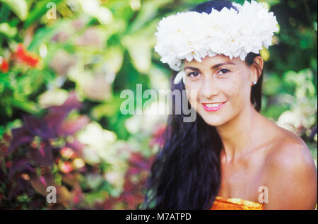 Portrait of a young woman smiling, Hawaii, USA - Stock Photo