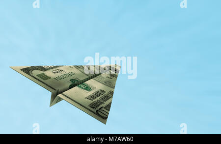 American bank note in the shape of an airplane flying in the sky - Stock Photo