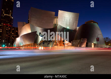 Buildings lit up at night in a city, Walt Disney Concert Hall, Los Angeles, California, USA - Stock Photo