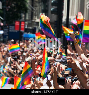 People carrying rainbow flags in gay pride parade, New York City, New York State, USA - Stock Photo