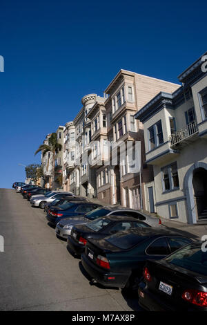 Cars parked in front of houses, San Francisco, California, USA - Stock Photo