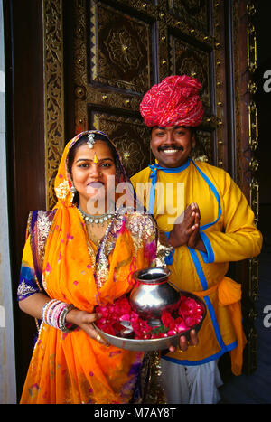 Portrait of a mid adult couple at a door and greeting, Jaipur, Rajasthan, India - Stock Photo