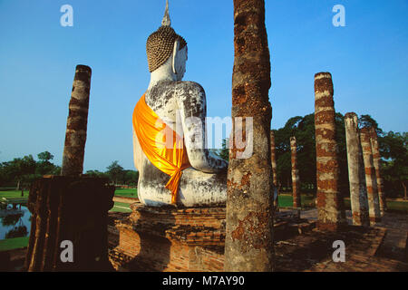 Old ruined of statue of Buddha in a temple, Wat mahathat, Sukhothai Historical Park, Sukhothai, Thailand - Stock Photo
