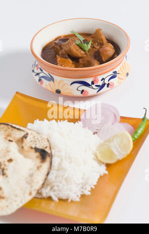 High angle view of mutton curry served with rice - Stock Photo