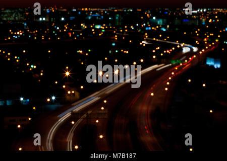 High angle view of a city lit up at night, Miami, Florida, USA - Stock Photo