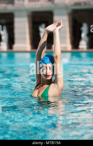 Woman doing water aerobics in a swimming pool, Biltmore Hotel, Coral Gables, Florida, USA - Stock Photo