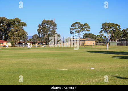 Adelaide Australia 10th March 2018. Players feel the heat during a local cricket match  on a hot summer day in Adelaide - Stock Photo