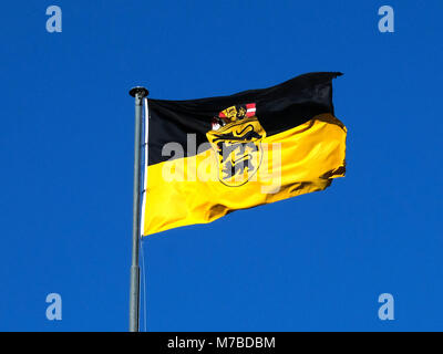 08 March 2018, Germany, Stuttgart: The flag of the German state Baden-Württemberg flies over the New Palace. Photo: - Stock Photo