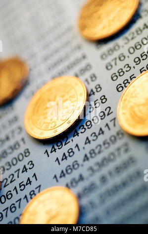 Close-up of Euro cent coins on financial figures - Stock Photo