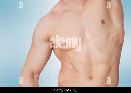 Close-up of a bare chested man - Stock Photo