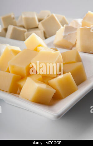 Cubes of assorted cheeses - Stock Photo