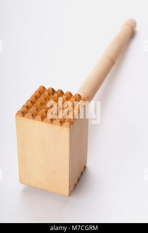 Close-up of a meat tenderizer hammer - Stock Photo