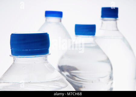 Close-up of four bottles of water - Stock Photo