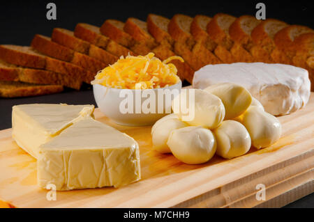High angle view of assorted cheeses served with bread - Stock Photo