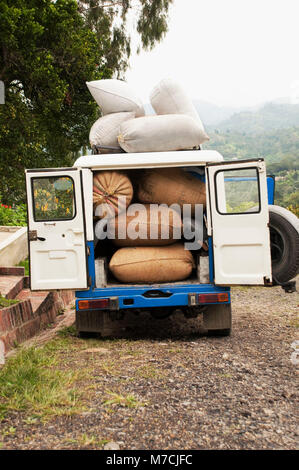 Sacks of coffee beans in a jeep, Colombia - Stock Photo