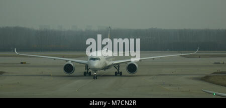Beijing, China - Feb 17, 2018. A civil aircraft on runway at Beijing Capital Airport (PEK), China. The airport is - Stock Photo