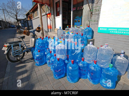 Drinking water bottles for distribution at a local store in a Beijing Hutong (alley), China - Stock Photo