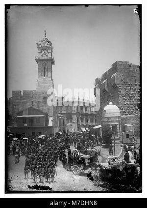 Marching in front of Am. (i.e., American) Colony store. Grand New Hotel (Jerusalem) LOC matpc.06380 - Stock Photo