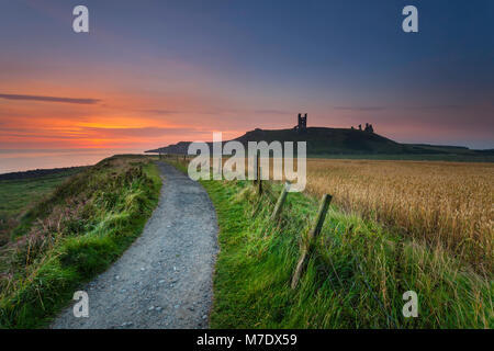 Dunstanburgh castle in Northumberland. - Stock Photo