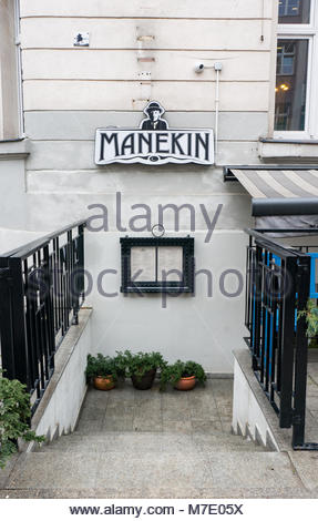 Poznan, Poland - March 07, 2018: Entrance with stairs leading down to a Manekin restaurant in the city center - Stock Photo