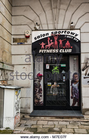Poznan, Poland - March 07, 2018: Entrance to a Salon Sportowy fitness club in the city center - Stock Photo