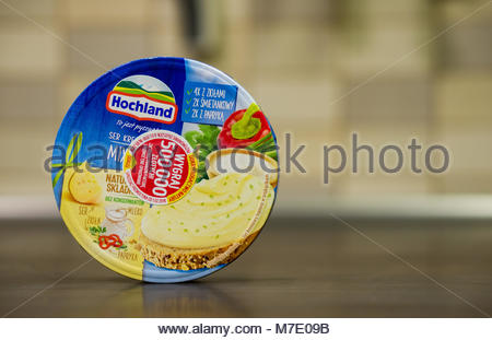 Poznan, Poland - March 07, 2018: Hochland cream cheese mix in a box with sticker informing about winning chance - Stock Photo