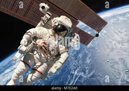 International Space Station and astronaut in outer space over the planet Earth. Elements of this image furnished - Stock Photo