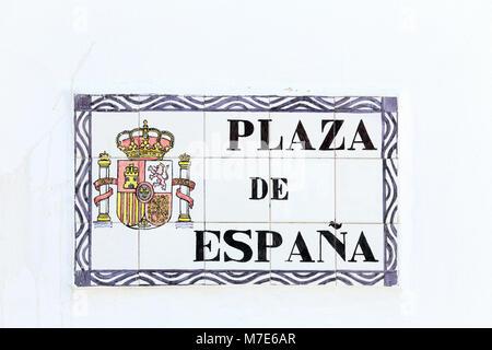 Plaza de España, a street sign on a whitewashed wall in Benalmadena, Costa del Sol, Spain. - Stock Photo