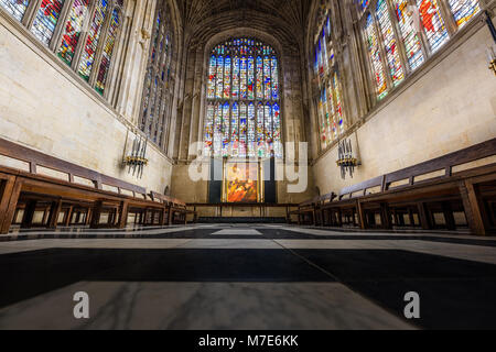 The choir with its floor, stained glass windows, altar, and painting by Rubens in the chapel at King's college, - Stock Photo