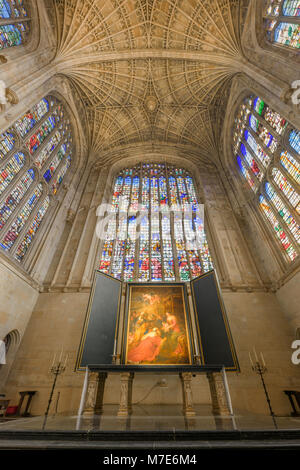 The choir with its floor, stained glass windows, fan ceiling, altar, and painting by Rubens in the chapel at King's - Stock Photo
