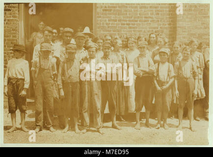 Part of the force at Tupelo (Miss.) Cotton Mills. All work. Smallest ones not in photo. Among youngest here are - Stock Photo