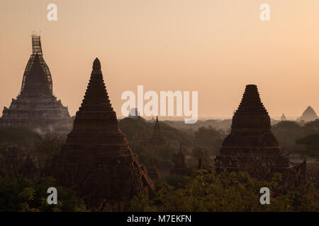 Scenic view of many temples and stupas as seen from the Law Ka Ou Shang Temple in Bagan, Myanmar (Burma) at sunrise. - Stock Photo