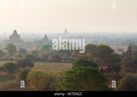 Several temples and pagodas at the ancient plain of Bagan viewed from the Shwesandaw Temple in Myanmar (Burma), - Stock Photo
