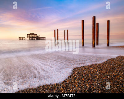 Winter sunrise at the old Pier, Brighton. - Stock Photo