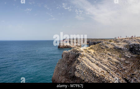 SAGRES, PORTUGAL - AUGUST 26, 2016: Tourists enjoying the view at Cape St. Vincent in Portugal - Stock Photo