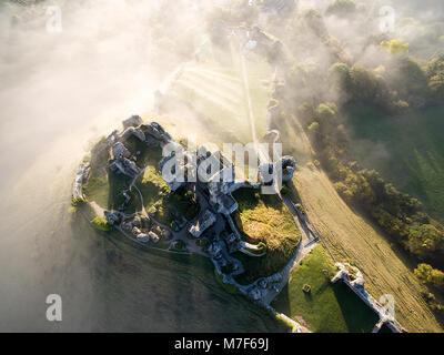 Misty Morning Sunrise at Corfe Castle aerial shot - Stock Photo