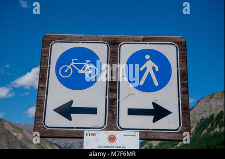 passing signs for pedestrians and cyclists - Stock Photo